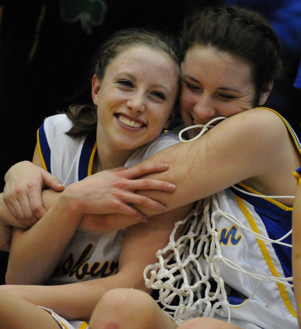Washburn girls basketball team members Carsyn Koch (left) and Olivia Doody celebrates their victory over Richmond 75-55 in the Class D state championship action on Saturday, March 2, at the Bangor Auditorium. Read the story