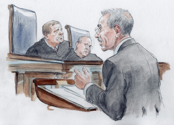 Solicitor General Donald Virrilli (right) argues in front of U.S. Supreme Court Chief Justice John Roberts (left) and Associate Justice Anthony Kennedy about the constitutionality of the Defense of Marriage Act in Washington, in this courtroom drawing released March 27, 2013.