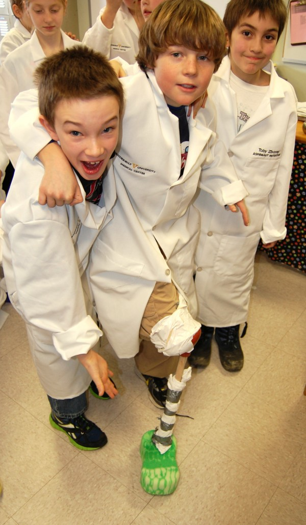 Surry Elementary School students Nick Kane (left), Russell LaMarre (center) and Nyamh Wolf did a &quotroad test&quot Friday of their engineering team's prototype for an artificial leg as part of an interactive distance learning project involving students and research scientists at Vanderbilt University.