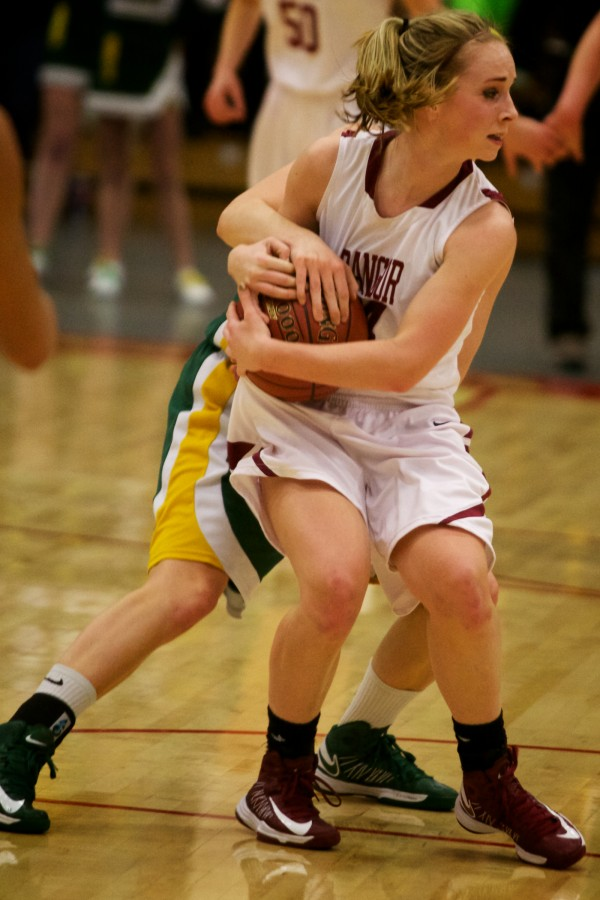 Bangor High School guard Sarah Bragg fights for the ball Saturday, March 2, in the Maine Class A Championship game at the Augusta Civic Center. Read the story