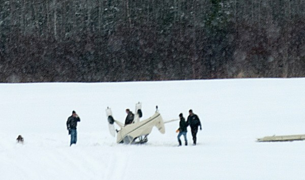 An overturned plane rests in the middle of Miller's air field on Wednesday, March 20, 2013.