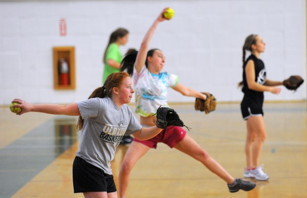 Softball pitchers participate during the first practice and tryout of the spring season at the Old Town High School Monday.