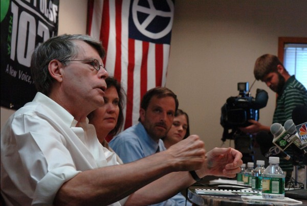 Stephen King (left), owner of Zone Radio in Bangor, answers questions during a news conference regarding programming on WZON 103.1FM and 620AM at the radio station's headquarters in Bangor in 2011.