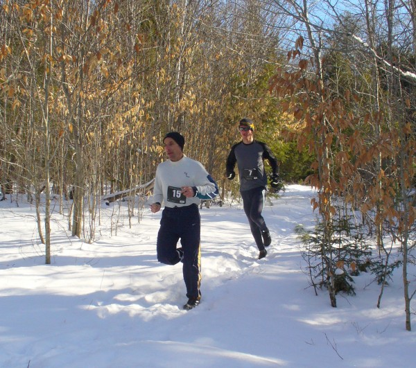 In the 2012 State of Maine Championship Snowshoe Race, Jeff Lombardo of Old Town, 24, runs behind race organizer Peter Keeney, 45, of Bar Harbor, on Jan. 22, 2012, in the Great Pond Mountain Wildlands in Orland. Farther along the course, Lombardo passes Kenney to win the race, running 4.9 rugged miles in 35 minutes, 8 seconds. Keeney placed second in the championships, which was run without snowshoes due to lack of snow.