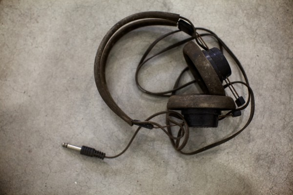 Headphones from Kestrel Aircraft lead mechanic Scott Royal's 1948 Luscombe two-seater sit in a Brunswick hangar. He's restoring the old plane and hopes to have it in the air by May.