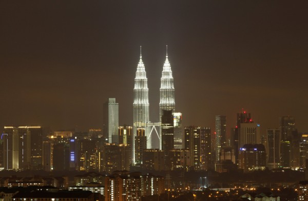 The Petronas Twin Towers in Kuala Lumpur, a Malaysian landmark, are pictured after lights were turned on after the Earth Hour in this March 31, 2012 photograph.