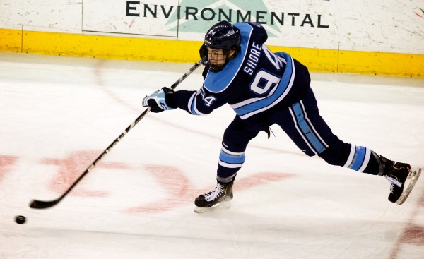 University of Maine freshman Devin Shore handles the puck in Hockey East playoff action against UMass Lowell Thursday night in Lowell, Mass. Shore led the team in scoring, finishing the season with six goals and 20 assists.
