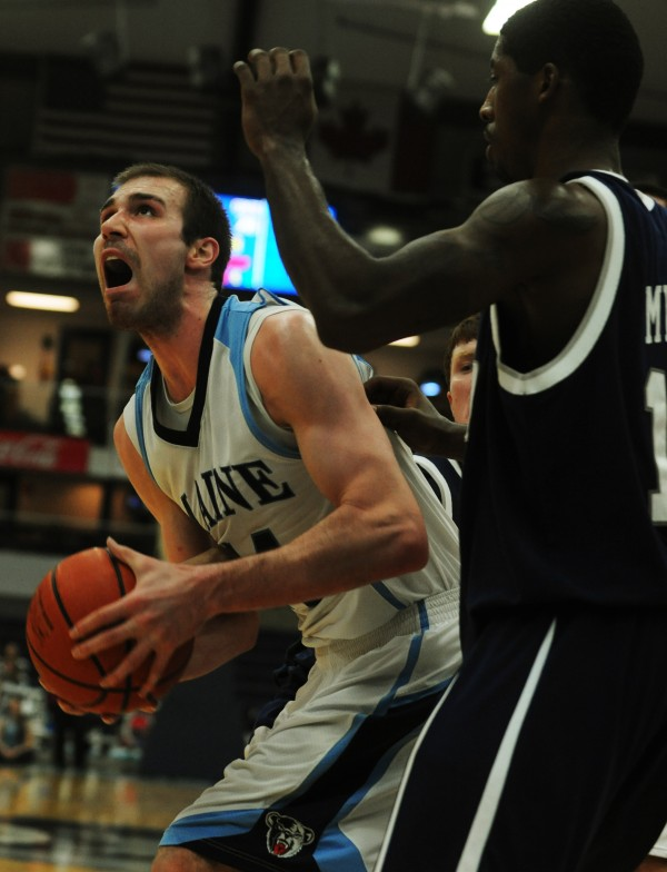 UMaine's Mike Allison looks to shoot while being guarded by New Hampshire's Ferg Myrick during first half action at Orono in January.