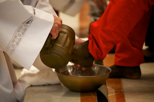 Rev. Louis Phillips washes feet at the Cathedral of the Immaculate Conception in Portland on Thursday. The ceremony mimics how Jesus humbly washed his disciples' feet before the Last Supper. The service aimed to raise awareness of suffering in the community. Read the story here.