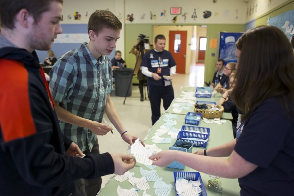 Brewer students Michael Grimble (left), 16, and Gehrig White, 17 make a pledge during their lunch hour to stop using the &quotR-word.&quot Brewer High School is sponsoring a campaign to replace the term mental retardation with intellectual disability.