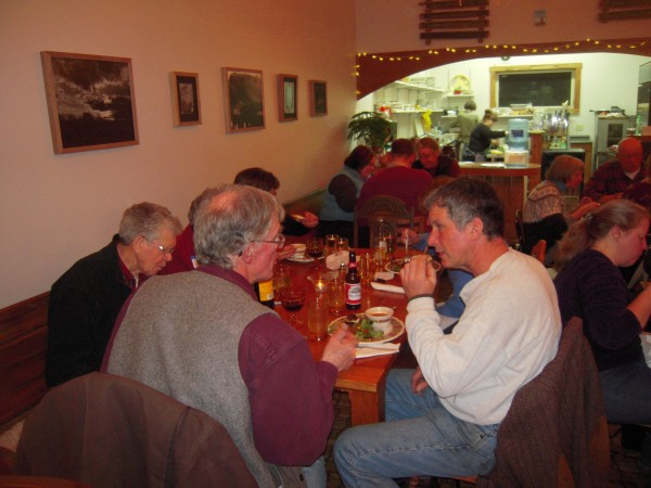 Mark Goughan of Goughan's Berry Farm in Caribou (right) chats with Rep. Bill Noon of Sanford (back to camera), a member of the Legislature's Agriculture, Conservation and Forestry Committee, over a locally sourced dinner in Presque Isle March 9. Also at the table are Phil and Jackie Doak (left) of Sunrise Farm in Woodland; Pam Sweetser, a Presque Isle cattle farmer; and Gloria Goughan.