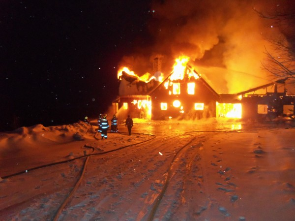 Firefighters battle a fully involved blaze at a house on Ross Hill Road in St. Albans on Friday morning. The two-story house was destroyed.