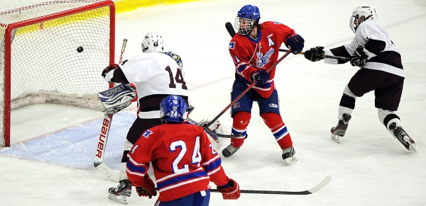 Greely's Adan Black (right) fires the puck into the back of the net for the first goal of the game during Saturday afternoon's Class B State Championship hockey game at the Androscoggin Bank Colisee in Lewiston. Greely won, 3-0.