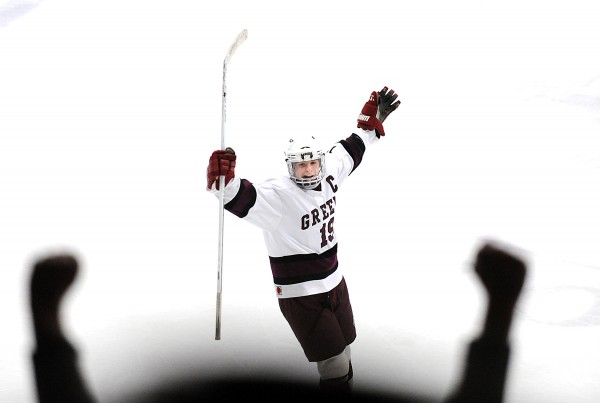 Greely's Ted Hart looks up into the crowd in celebration after time ran out on Saturday afternoon's Class B State Championship hockey game at the Androscoggin Bank Colisee in Lewiston where his team defeated Greely, 3-0.
