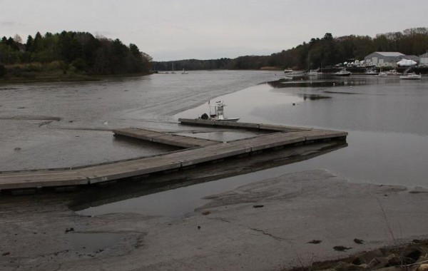 A dock on the Royal River sits in the mud during a low tide last year. Yarmouth is in line for money to dredge its harbor, although it's unclear if the funding will come through.