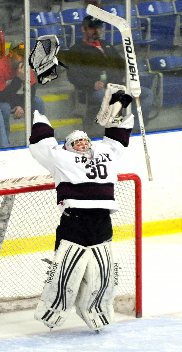 Greely goalie Kyle Kramlich celebrates as time runs out during Saturday afternoon's Class B State Championship hockey game at the Androscoggin Bank Colisee in Lewiston, where he recorded a 3-0 shutout over Messalonskee.
