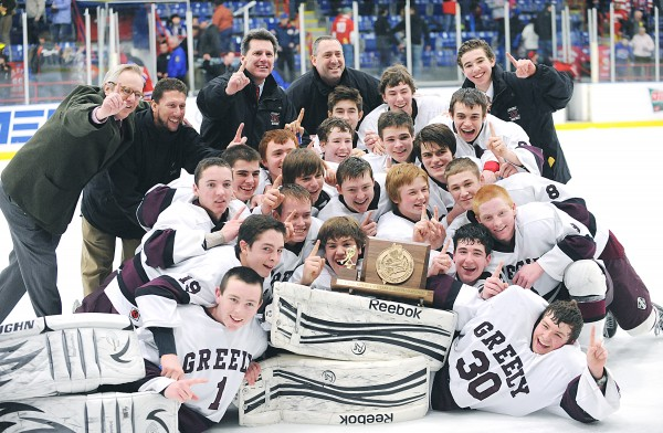 Greely's boys' hockey team poses for a championship photo after winning the Class B state title in a 3-0 match with Messalonskee at the Androscoggin Bank Colisee in Lewiston.