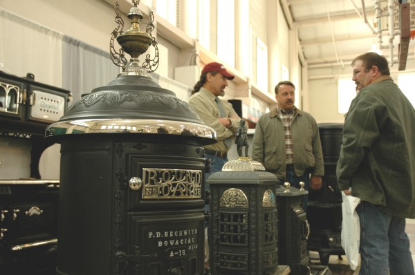 David Erickson (left), owner of Littleton, Mass.-based Erickson's Antique Stoves, discusses antique stoves with attendees of the Old House Trade Show in Portland in 2007. Erickson will be an exhibitor at the 2013 Old House Trade Show, Saturday and Sunday, March 23-24, in Portland.