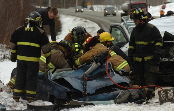 Emergency responders work to remove Louise Boudreau-Bouchard from her vehicle after she was hit head-on by an SUV driven by William Hinkle Jr. while heading north on Route 1A in Frankfort in March 2011. Boudreau-Bouchard was taken to Eastern Maine Medical Center in Bangor by LifeFlight helicopter, and Hinkle was taken to EMMC by ambulance.