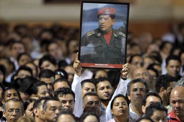 A Nicaraguan supporter of Venezuelan President Hugo Chavez holds a poster of him at the Revolution Square in Managua, Nicaragua, on Tuesday, March 5, 2013. Chavez died on Tuesday after a two-year battle with cancer, ending 14 years of tumultuous rule that made the socialist leader a hero for the poor but a hate figure to his opponents.