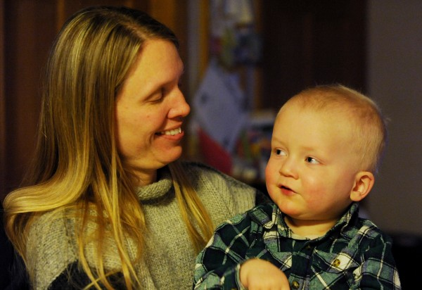 Camden Bryant sits with his mother Sheri at the families Eddington home on Friday. Camden is being treated for leukemia and will not know if he is disease free until he is almost ten years old.