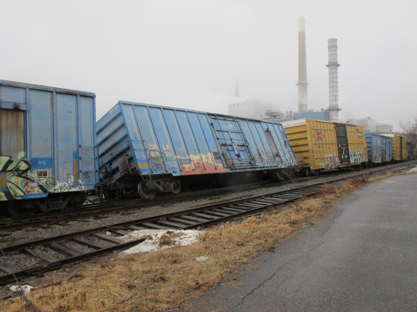 Four boxcars in a 13-car Pan Am Railways train jumped the tracks sometime Tuesday just south of the Verso Paper mill in Bucksport.
