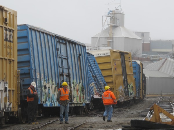 Several Pan Am Railways employees arrived with heavy machinery at the scene of the derailment on Wednesday morning.