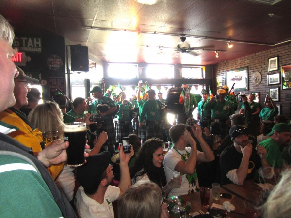 The crowd applauds for the Maine Public Safety Pipe & Drum Corps at Byrnes Irish Pub in Brunswick Sunday.