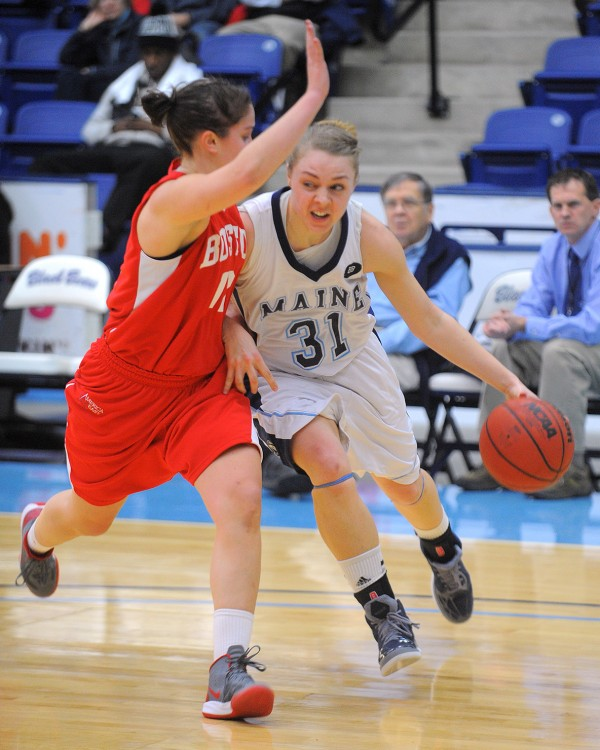 The University of Maine's Liz Wood drives on Boston University's Danielle Callahan during a game on Jan. 16 in Orono. Maine struggled to a 4-24 record this season, but Wood was a bright spot, averaging 10.3 points per game and a team-leading 6.6 rebounds in her first season.