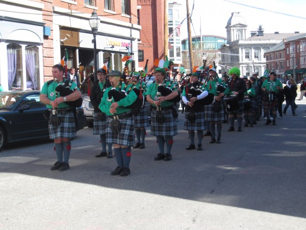 The Maine Public Safety Pipe & Drum Corps stands outside Bull Feeney's on Fore Street in Portland on Sunday.