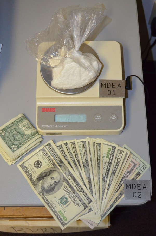 The Maine Drug Enforcement Agency displays evidence allegedly seized from car of Nega M. Negash, 39, of Portland, on Friday. Agents allegedly discovered about six ounces of suspected crack cocaine and nearly $2,000 in cash during preliminary searches of Negash's vehicle.