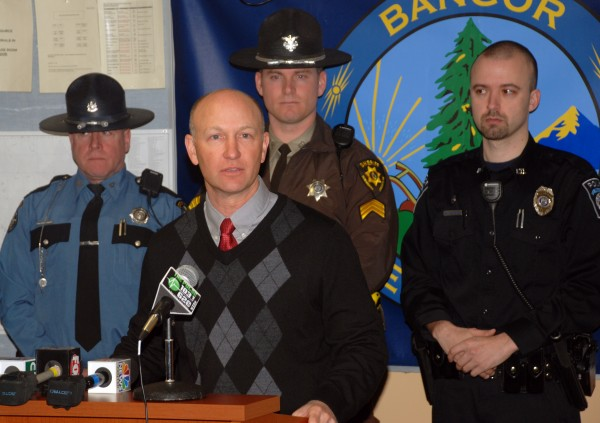 Gerry Chasse, president of Bangor Hydro and Maine Public Service, speaks on March 22, 2013 about increasing rates of copper and electricity thefts, with members of the Maine State Police, Penobscot County Sheriff's Department and Veazie Police Department standing behind him.