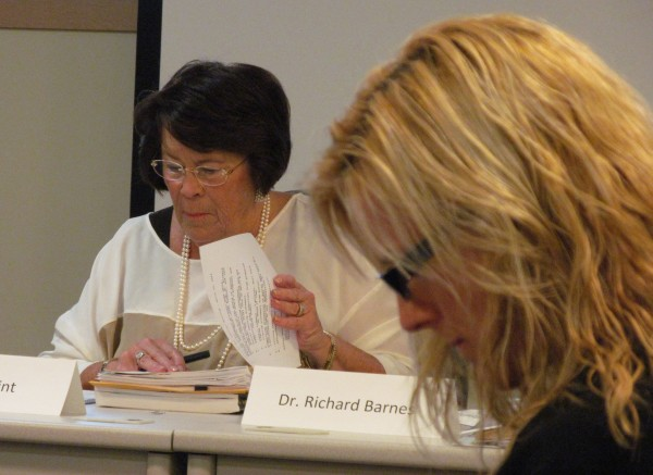 Jana Lapoint, chairwoman of the Maine Charter School Commission, reviews documents associated with the application for the proposed Baxter Academy for Technology and Science on Monday morning while academy board member Allison Crean Davis does likewise in the foreground. The commission held a meeting on the proposed Baxter Academy on Monday in Augusta.