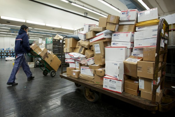 A United States Postal Service employee sorts packages at the Lincoln Park Carriers Annex in Chicago on Nov.  29, 2012.