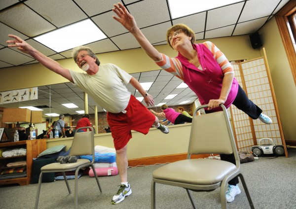 George and Kate Giffin work out together as part of a fitness class at the Hammond Street Senior Center on Bangor on Monday. The Giffins retired to the Bangor area about a year ago after living in several other locations including New Hampshire and Nova Scotia. The say they are New England people, they have the clothes for it, added George.