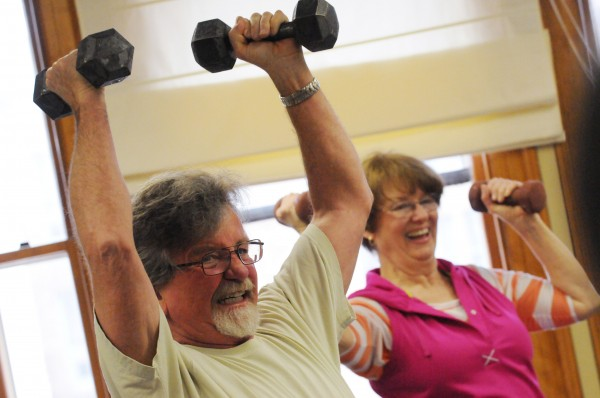George and Kate Giffin work out together as part of a fitness class at the Hammond Street Senior Center on Bangor on Monday. The Giffins retired to the Bangor area about a year ago after living in several other locations including New Hampsire and Nova Scotia. The say they are New England people, they have the clothes for it added George.
