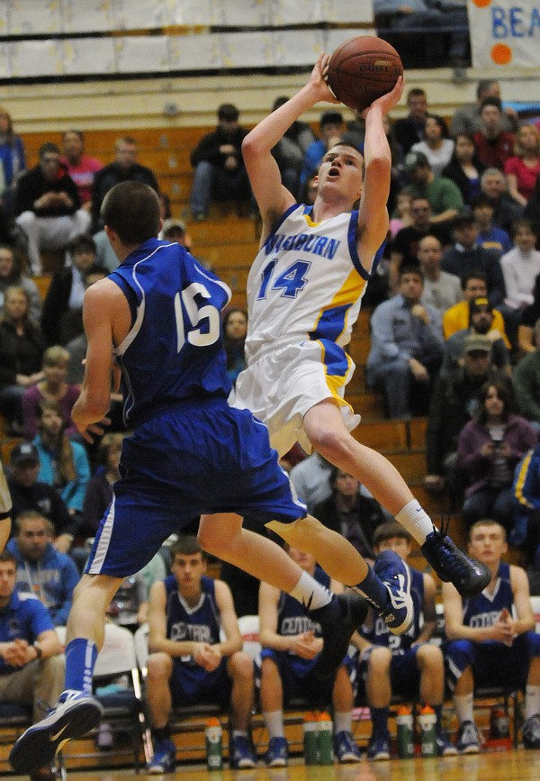 Washburn's Mitchell Worcester takes a shot over Central Aroostook's Chandler Brewer during first half action on Feb. 21, 2013, at the Bangor Auditorium during class D tourney action.