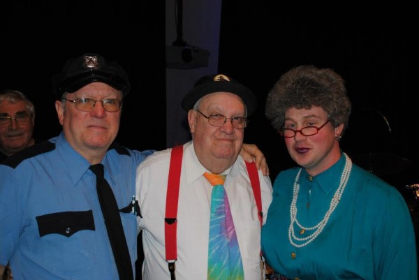 Taking a few moments before hitting the stage of Fort Kent Lions show members Pat Labbe, Ellery Labbe and Kris Malmborg as the Cop, Ti-Joe and Tante Rose, respectively.
