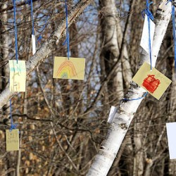 "Messages to Nathan Capponi are tied to a birch dubbed ""Nathan's Tree"" on the playground of Greene Central School Thursday afternoon. Capponi, 6, was struck and killed by his father at their Greene home as the father, Kevin, was plowing their Quaker Ridge driveway."