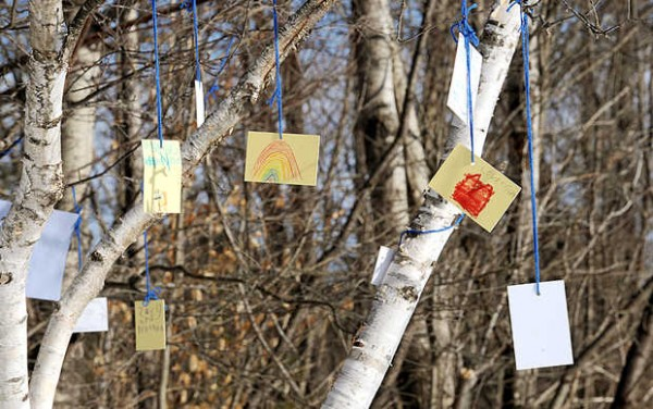 Messages to Nathan Capponi are tied to a birch dubbed &quotNathan's Tree&quot on the playground of Greene Central School Thursday afternoon. Capponi, 6, was struck and killed by his father at their Greene home as the father, Kevin, was plowing their Quaker Ridge driveway.