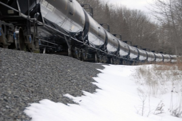 A long line of train tanker cars sits in Winn a few miles south of a train derailment in Mattawamkeag on Thursday, March 7, 2013. It was unclear whether the tankers were part of the derailed train or brought up to handle the crude oil to be offloaded from the derailment site.