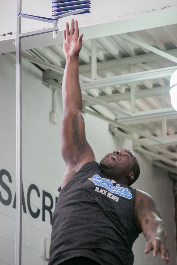 David Toriola does the vertical jump drill during the University of Maine's football Pro Day workouts on Wednesday, March 20, 2013.