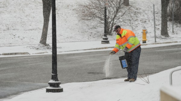 &quotI'm just putting down some salt so people don't slip,&quot said Gene Bridges, as he spread salt along the sidewalk on Franklin Street in Bangor on Tuesday.