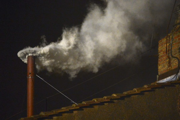 White smoke rises from the chimney on the Sistine Chapel indicating that a new pope has been elected at the Vatican, March 13, 2013.
