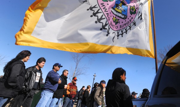 About 100 people came to a press conference to voice their opposition to regulations that limit the number of elver fishing licenses that can be issued by the Passamaquoddy Tribe. They gathered outside the Wabanaki Heritage Center in Calais on Sunday afternoon.