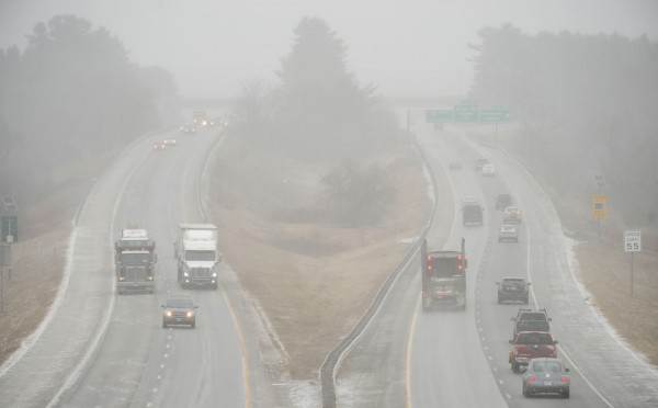 Light snow obscures traffic along I-95 in Bangor on Tuesday.