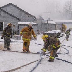Stubborn fire destroys Troy farmhouse