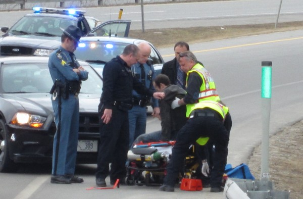 Freeport rescue personnel and police help a man involved in a crash on Interstate 295 in Freeport onto a stretcher Wednesday afternoon.