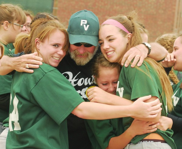Eliza Pelletier (24) (left), Head Coach Thomas Coyle, Kirstin Batchelder (1) and Reese Leonard (10) (far left) of Penobscot Valley High School all celebrate after defeating Richmond High School for the Class D State Softball Championship at Coffin Field in Brewer Saturday, June 16, 2012.