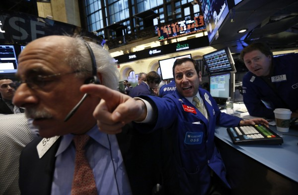 Barclay's specialist trader Michael Pistillo shouts out a price just after the opening bell on the floor at the New York Stock Exchange, March 15, 2013.
